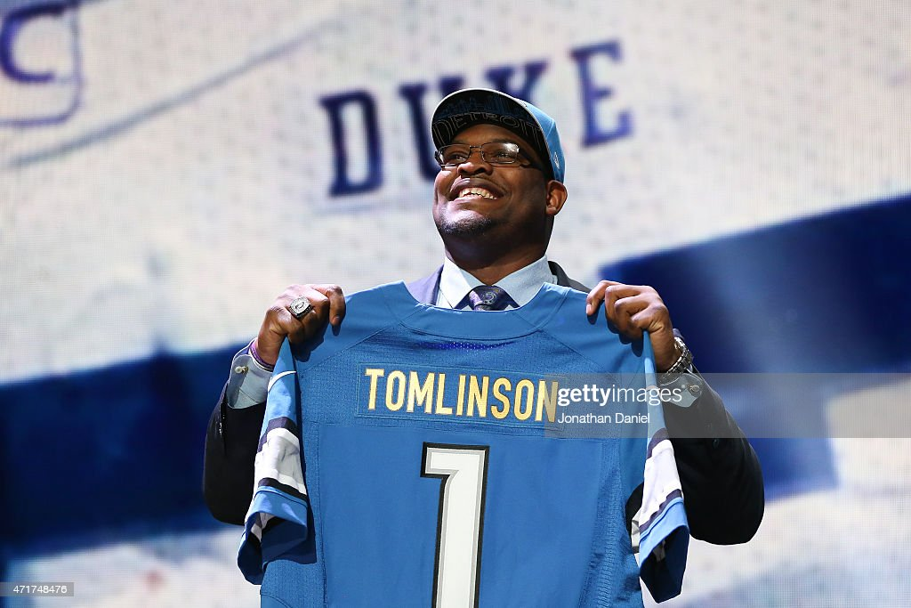 Laken Tomlinson of the Duke Blue Devils holds up a jersey after being picked #28 overall by the Detroit Lions during the first round of the 2015 NFL Draft at the Auditorium Theatre of Roosevelt University on April 30, 2015 in Chicago, Illinois.