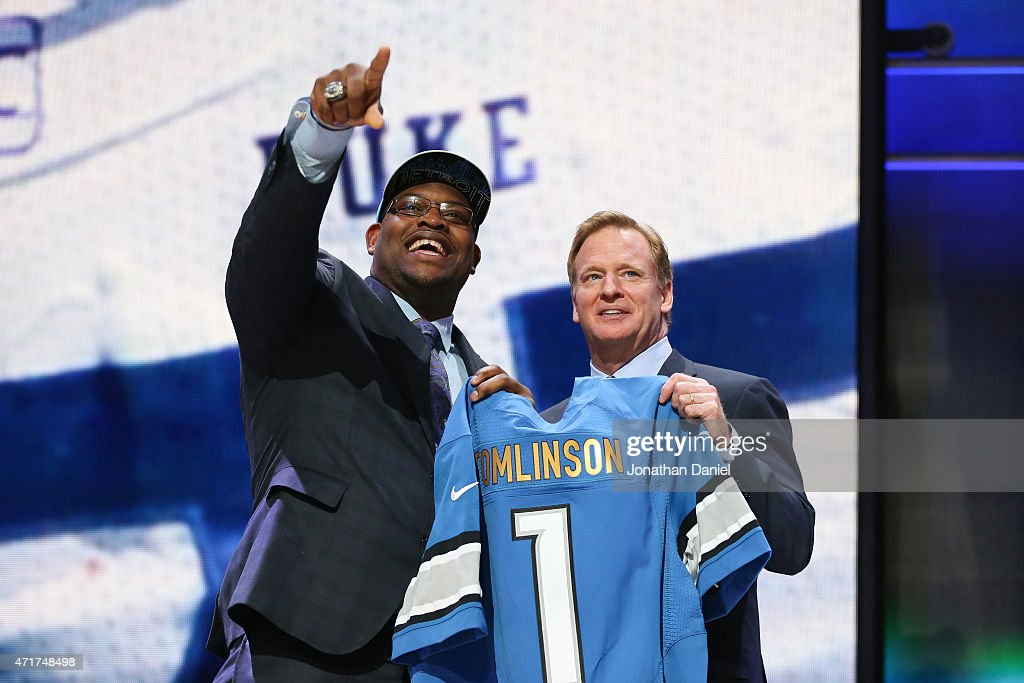 Laken Tomlinson of the Duke Blue Devils holds up a jersey with NFL Commissioner Roger Goodell after being picked #28 overall by the Detroit Lions during the first round of the 2015 NFL Draft at the Auditorium Theatre of Roosevelt University on April 30, 2015 in Chicago, Illinois.