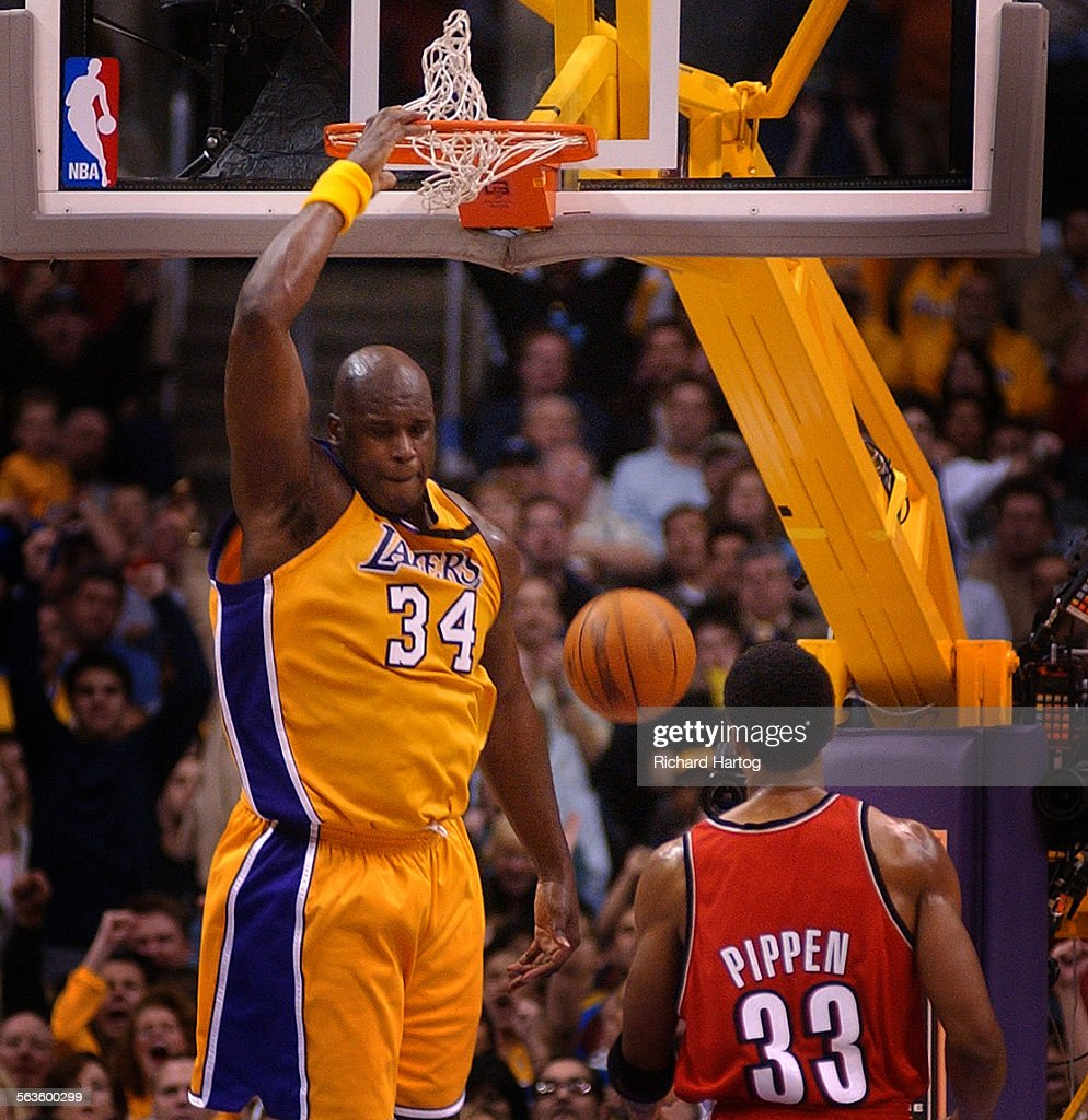Laker center Shaquille O Neal finishes off a slam dunk as