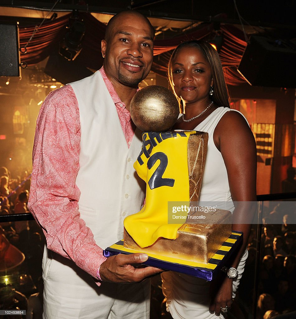 LA Laker <a gi-track='captionPersonalityLinkClicked' href=/galleries/search?phrase=Derek+Fisher&family=editorial&specificpeople=201724 ng-click='$event.stopPropagation()'>Derek Fisher</a> (L) celebrates his five time championship win with his wife Candace Fisher (R) at TAO Nightclub at the Venetian on June 26, 2010 in Las Vegas, Nevada.