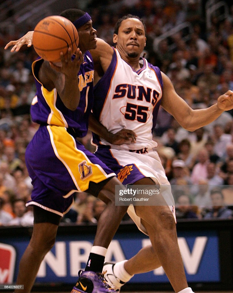 Laker guard Smush Parker is flagrently fouled by Phoenix Suns