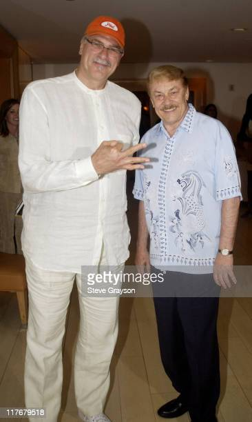 Laker head coach Phil Jackson and Dr Jerry Buss pose for photographers at the Los Angeles Lakers victory celebration at Ian Schrager's Ultra Chic...