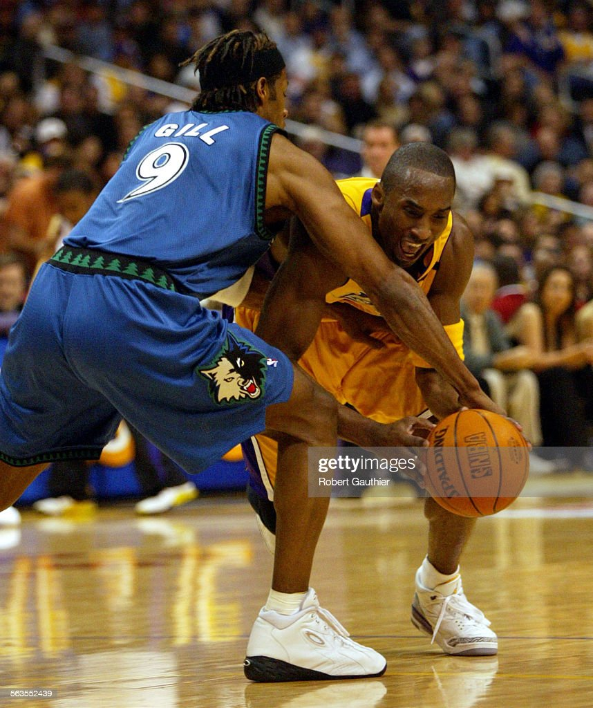 Laker Kobe Bryant drives on the Minnesota Timberwolves Kendall