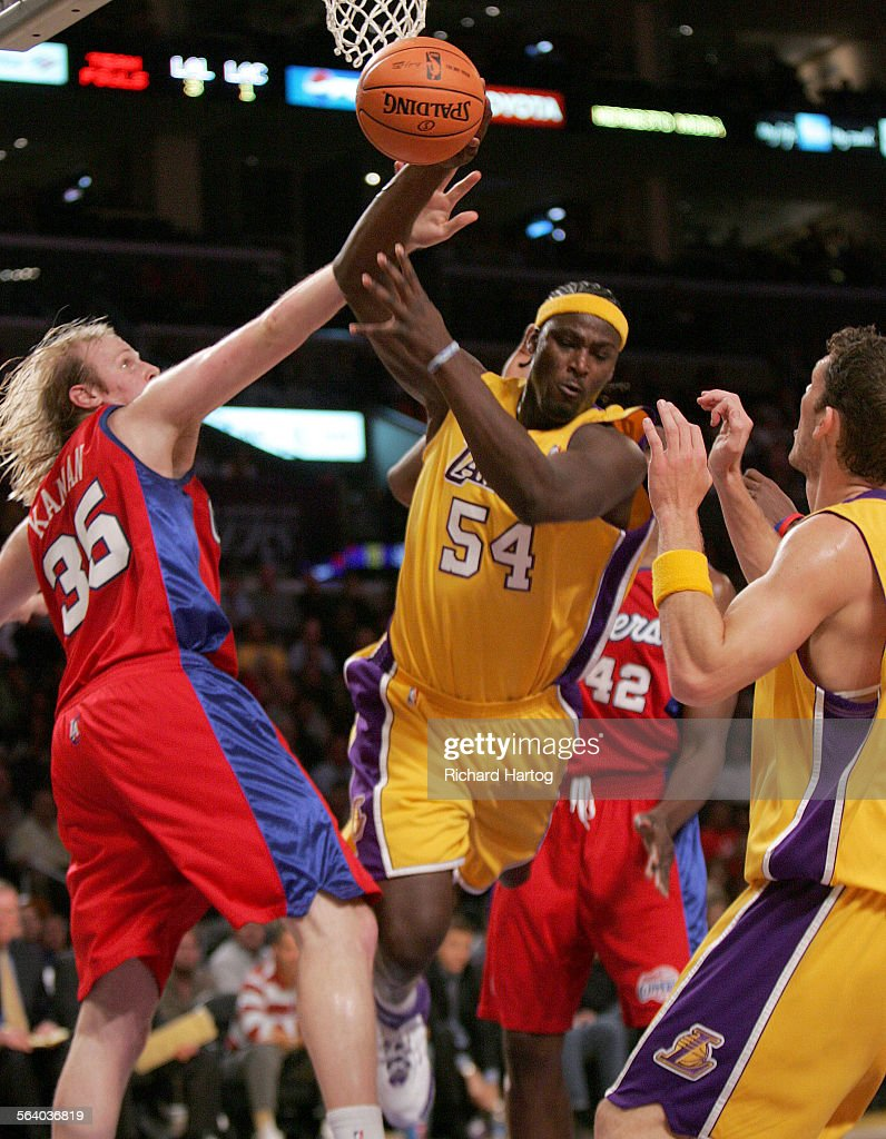 Laker Kwame Brown is fouled by Clipper Chris Kaman as he goes to