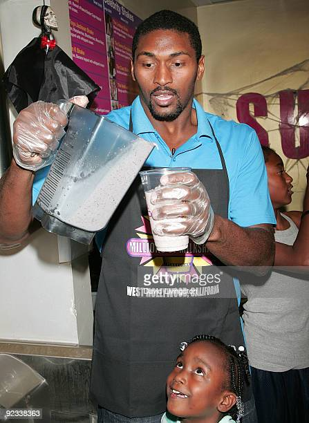 A Laker Ron Artest and his daughter Diamond attend the launch of his new milkshake at Millions of Milkshakes on October 25 2009 in West Hollywood...