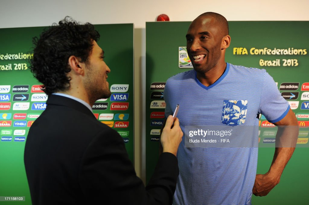 LA Lakers basketball star Kobe Bryant is interviewed prior to the FIFA Confederations Cup Brazil 2013 Group A match between Italy and Brazil at Estadio Octavio Mangabeira (Arena Fonte Nova Salvador) on June 22, 2013 in Salvador, Brazil.