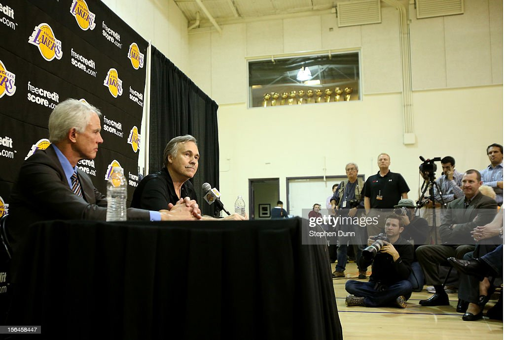 Lakers general manager <a gi-track='captionPersonalityLinkClicked' href=/galleries/search?phrase=Mitch+Kupchak&family=editorial&specificpeople=753399 ng-click='$event.stopPropagation()'>Mitch Kupchak</a> (L) and coach <a gi-track='captionPersonalityLinkClicked' href=/galleries/search?phrase=Mike+D%27Antoni&family=editorial&specificpeople=203175 ng-click='$event.stopPropagation()'>Mike D'Antoni</a> speak at a press conference introducing D'Antoni as the new Los Angeles Lakers head coach beneath a display of Lakers championship trophies on November 15. 2012 at the Lakers practice facility at the Toyota Sports Center in El Segundo, California.