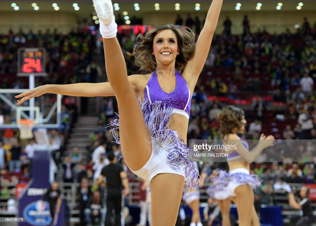 A Lakers Girl cheerleader performs during the LA Lakers and Golden State Warriors NBA Global Game 2013 tour game at the Wukesong Stadium in Beijing on October 15, 2013. The Warriors went on to win 100-95. The NBA Global Games sees a total of 12 NBA teams playing in seven different countries around the world. AFP PHOTO /Mark RALSTON