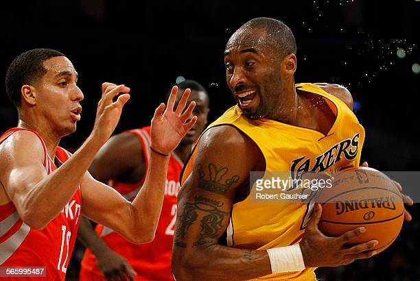 Lakers guard Kobe Bryant spins on Rockets defender Kevin Martin as he attempts a shot late in the game at Staples Center