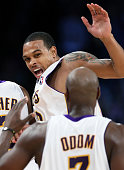 Lakers guard Shannon Brown celebrates with teammates Derek Fisher and Lamar Odom after hitting a half court shot at the third quarter buzzer against...