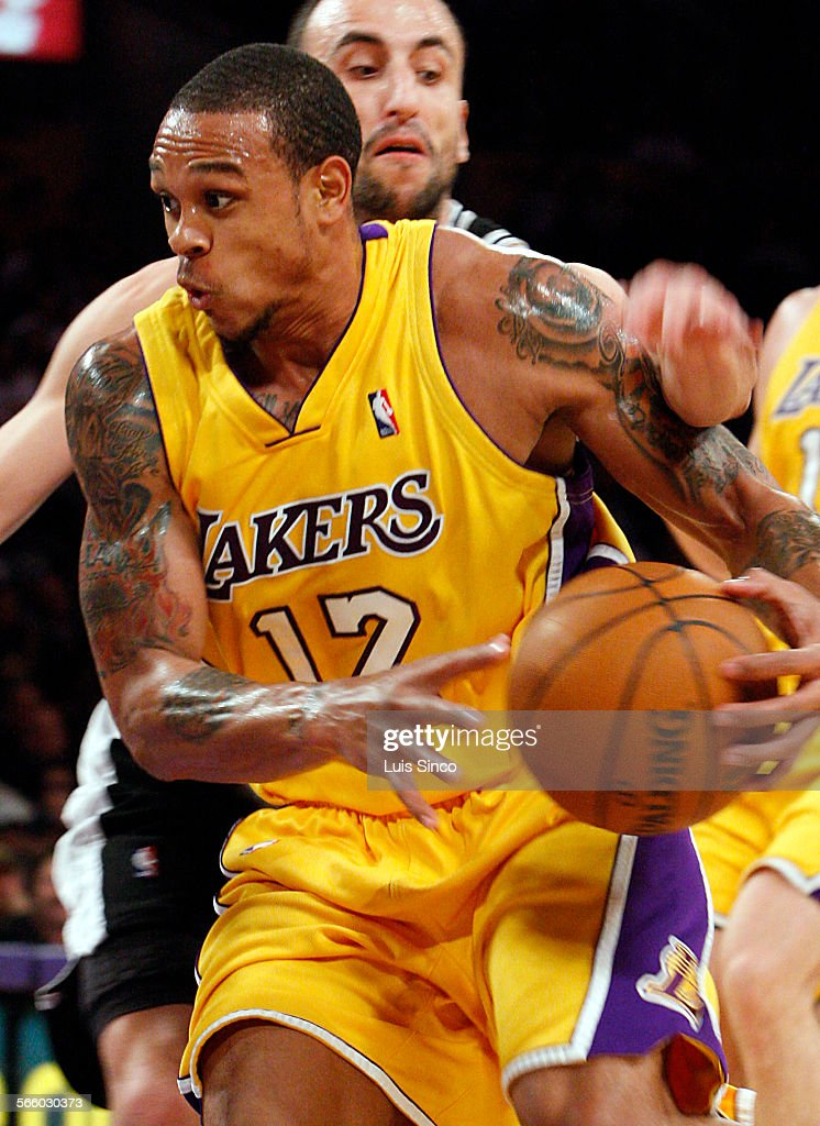 Lakers guard Shannon Brown gets fouled by Spurs guard Manu Ginobli while driving to the basket in the first quarter Monday Feb 8 at Staples Center
