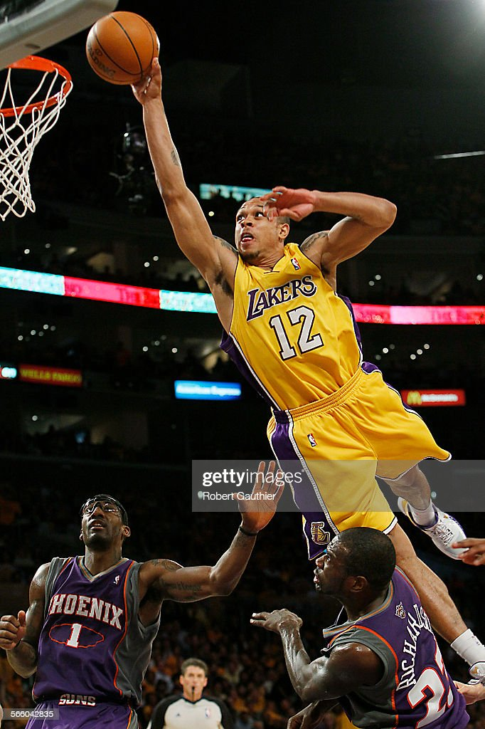Lakers guard Shannon Brown leaps over Suns defender Jason Richardson for an unsuccessful dunk attempt in the fourth quarter in game one of the...
