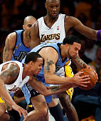 Lakers guard Shannon Brown rips the ball from Jazz guard Deron Williams as Lamar Odom looks on in the first half of game one of the NBA Western...