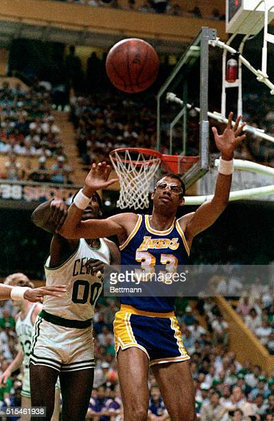 Lakers' Kareem Abdul Jabbar and Celtics' Robert Parrish both go for loose ball during the 1st quarter in the final game of the NBA Championship at...