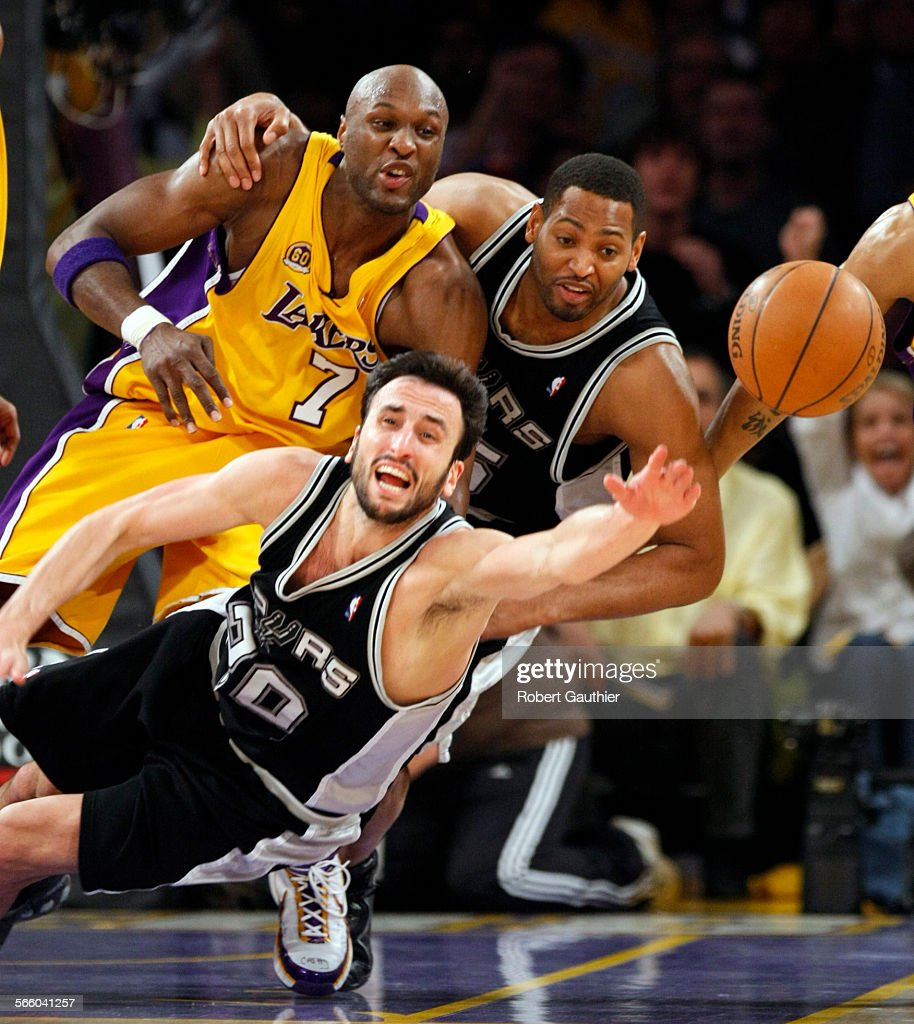 Lakers Lamar Odom s held by the San Antonio Spurs Robert Horry
