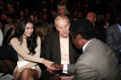 Lakers owner Jerry Buss and guest attend the 20th Anniversary Of The Magic Johnson Foundation Press Conference held at the Staples Center on November...