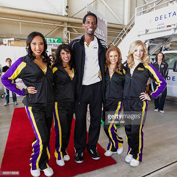 Lakers player AC Green attends as Delta Air Lines host 'Holiday Flight to the North Pole' at LAX Airport on December 11 2013 in Los Angeles California