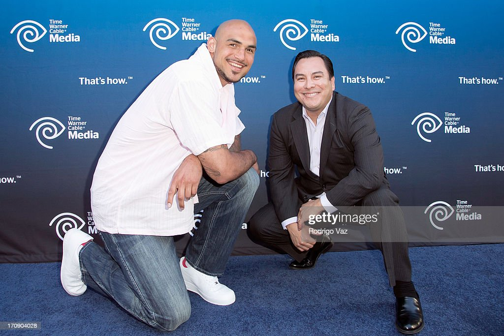 LA Lakers player Robert Sacre (L) and commentator Adrian Garcia Marquez attend the Time Warner Cable Media (TWC Media) 'View From The Top' Upfront at Vibiana on June 19, 2013 in Los Angeles, California.
