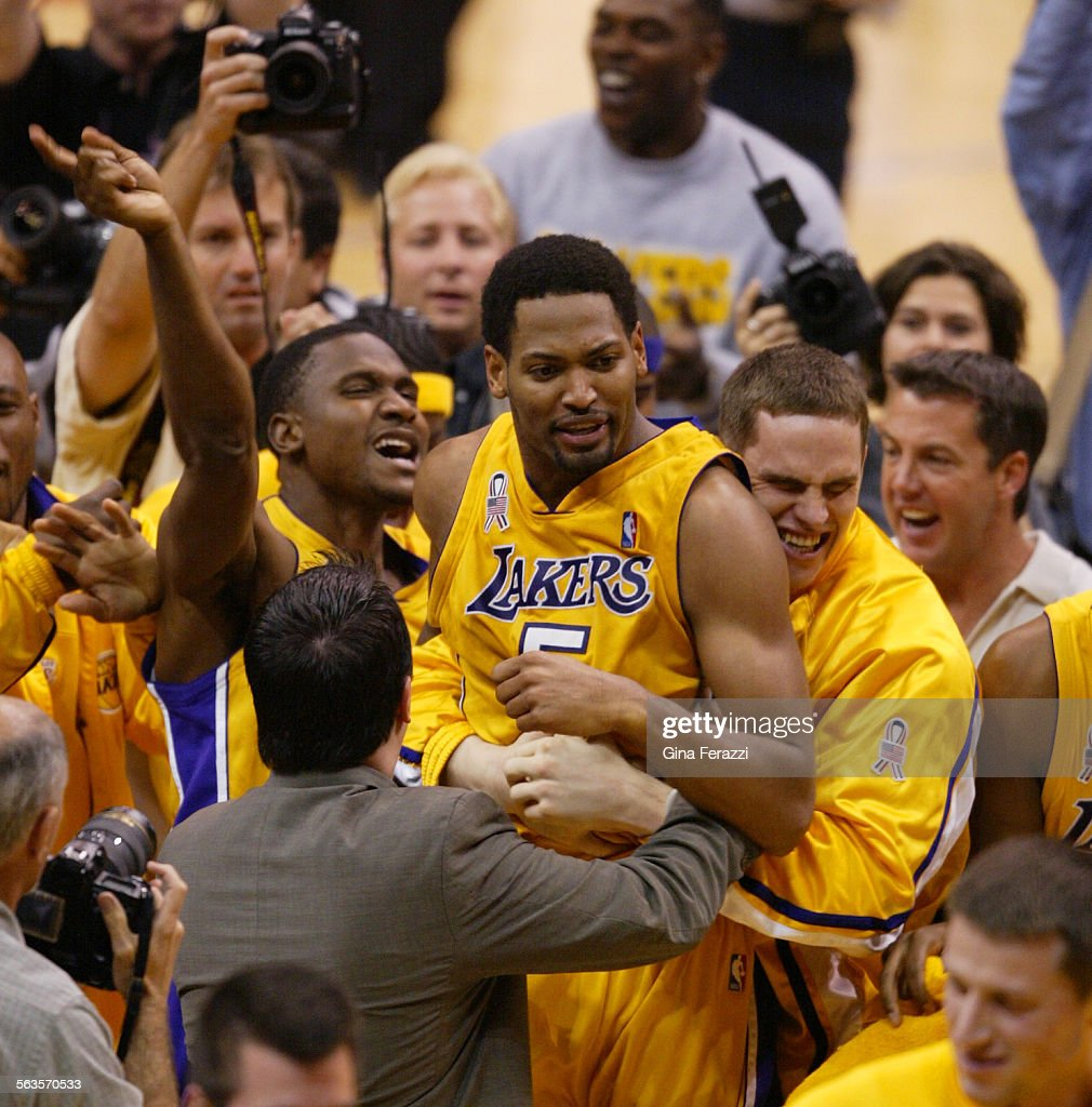 Lakers Robert Horry is swarmed by teammates after sinking the game