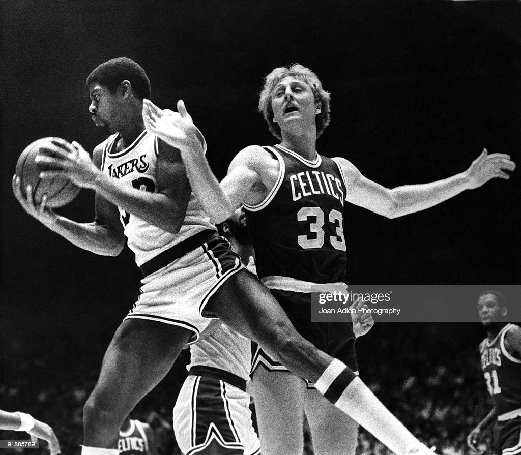 Lakers rookie Magic Johnson rips a rebound from the hands of Boston Celtics rookie Larry Bird during the first half at the Forum on October 28 1979...