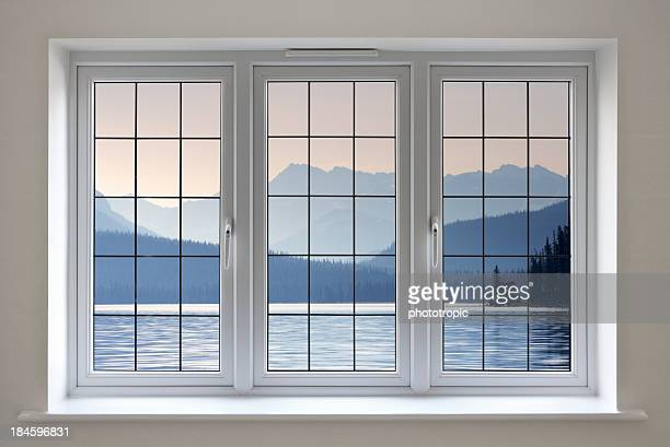 lakeside view through white leaded windows