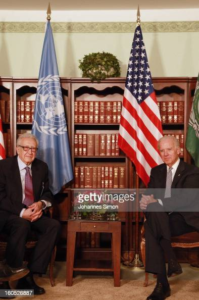 Lakhdar Brahimi UN joint special representative and US vice president Joe Biden pose ahead of a bilateral meeting at Hotel Bayerischer Hof on...