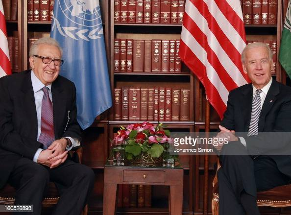 Lakhdar Brahimi UN joint special representative and US vice president Joe Biden laugh ahead of a bilateral meeting at Hotel Bayerischer Hof on...