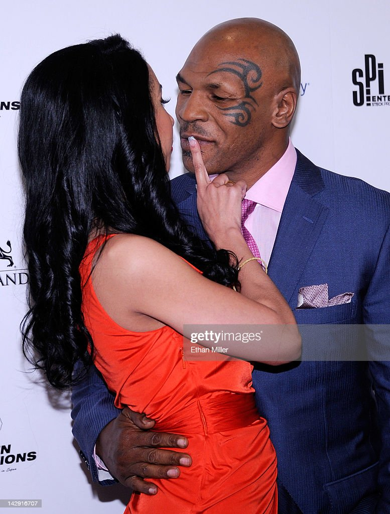 Lakiha 'Kiki' Tyson (L) and her husband <a gi-track='captionPersonalityLinkClicked' href=/galleries/search?phrase=Mike+Tyson&family=editorial&specificpeople=194986 ng-click='$event.stopPropagation()'>Mike Tyson</a> arrive at the grand opening of <a gi-track='captionPersonalityLinkClicked' href=/galleries/search?phrase=Mike+Tyson&family=editorial&specificpeople=194986 ng-click='$event.stopPropagation()'>Mike Tyson</a>'s one-man show '<a gi-track='captionPersonalityLinkClicked' href=/galleries/search?phrase=Mike+Tyson&family=editorial&specificpeople=194986 ng-click='$event.stopPropagation()'>Mike Tyson</a>: Undisputed Truth - Live on Stage' at the Hollywood Theatre at the MGM Grand Hotel/Casino April 14, 2012 in Las Vegas, Nevada.