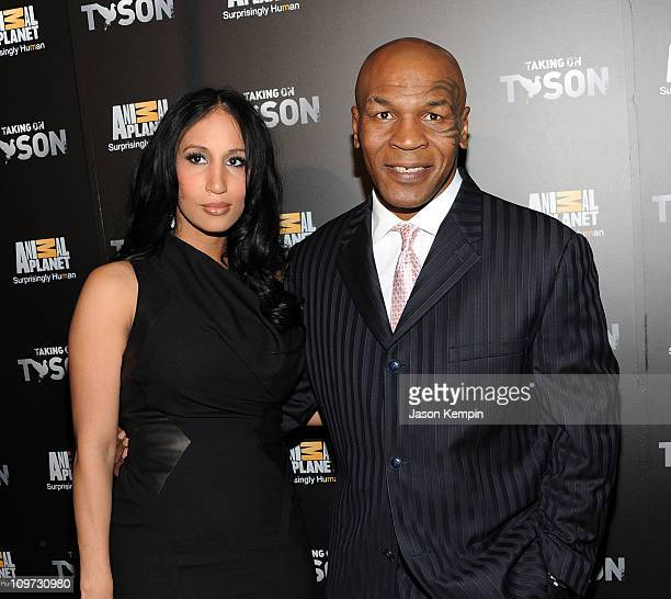 Lakiha Spicer and husband Mike Tyson attend the 'Taking on Tyson' New York premiere at Gansevoort Park Avenue on March 2 2011 in New York City