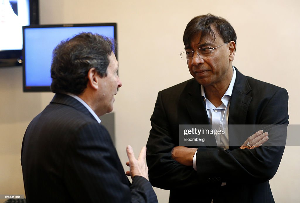 Lakshmi Mittal chief executive officer of ArcelorMittal right speaks to a fellow delegate on day three of the World Economic Forum in Davos...