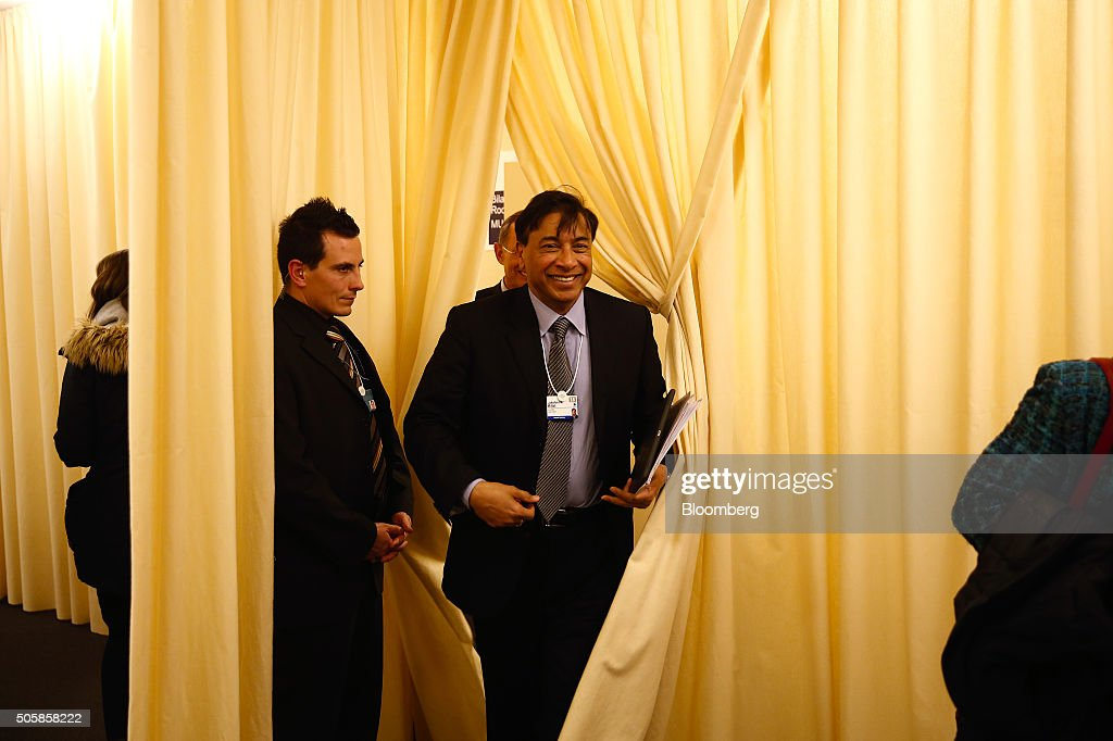 Lakshmi Mittal chief executive officer of ArcelorMittal walks out from behind a curtain following a meeting at the World Economic Forum in Davos...