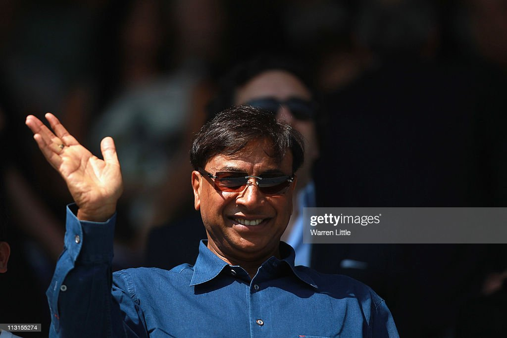 Lakshmi Mittal the CEO and Chairman of ArcelorMittal waves ahead of the npower Championship match between Queens Park Rangers and Hull City at Loftus...