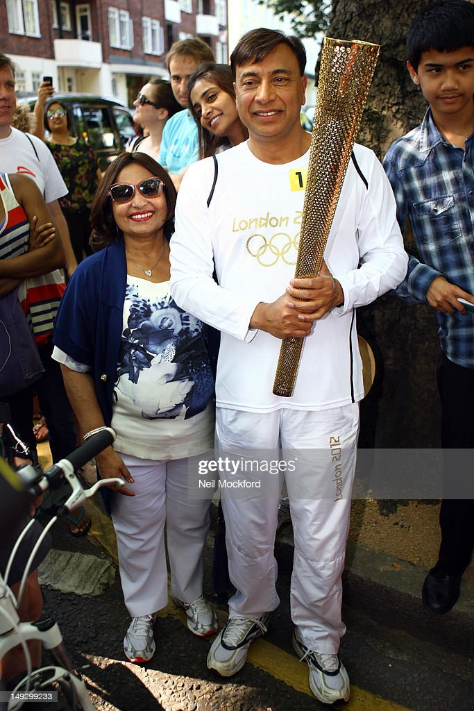 Lakshmi Mittal with The Olympic Torch On Day 69 Of The Olympic Torch Relay on July 26 2012 in London England