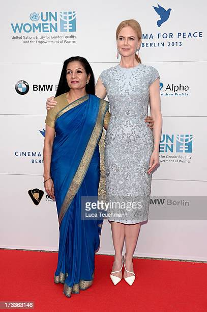Lakshmi Puri and Nicole Kidman arrives for the Cinema for Peace UN women honorary dinner at Soho House on July 12 2013 in Berlin Germany