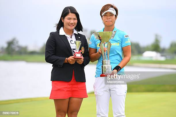 Lala Anai and Yumi Matsubara of Japan pose with the trophy after winning the Golf 5 Ladies Tournament 2016 at the Golf 5 Country Bibai Course on...