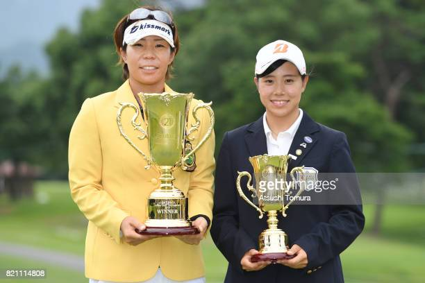 Lala Anai of Japan and Minori Iwsaki of Japan pose with the trophy during the final round of the Century 21 Ladies Golf Tournament 2017 at the Seta...