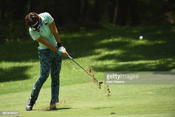 Lala Anai of Japan plays her approach shot on the 14th hole during the final round of the HokennoMadoguchi Ladies at the Fukuoka Country Club Wajiro...