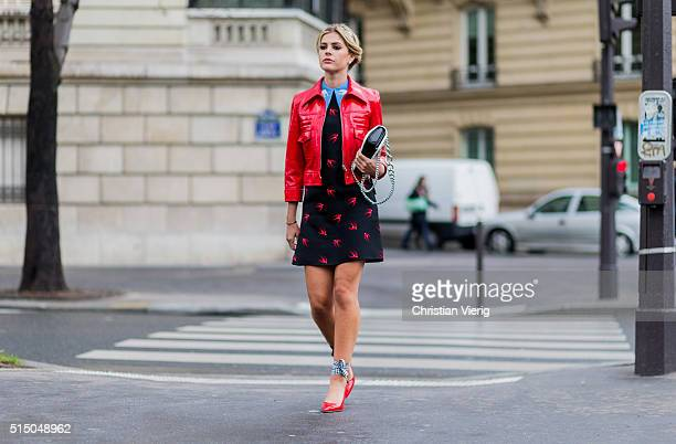 Lala Rudge wearing red Miu Mku heels leather jacket and dress outside Miu Miu during the Paris Fashion Week Womenswear Fall/Winter 2016/2017 on March...