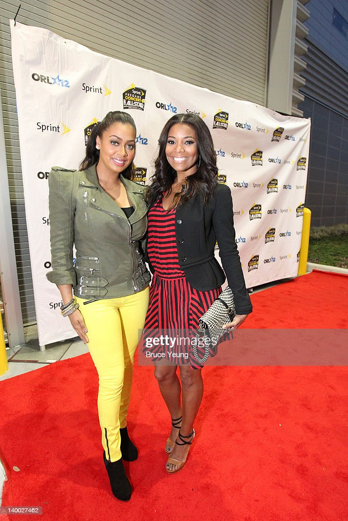 Lala Vasquez and <a gi-track='captionPersonalityLinkClicked' href=/galleries/search?phrase=Gabrielle+Union&family=editorial&specificpeople=202066 ng-click='$event.stopPropagation()'>Gabrielle Union</a> arrive on the red carpet prior to the 2012 NBA All-Star Game presented by Kia Motors as part of 2012 All-Star Weekend at the Amway Center on February 26, 2012 in Orlando, Florida.