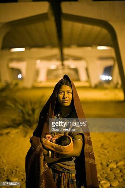 Lali 28 and the baby Mia beneath the IIT flyover where they sleep New Delhi India
