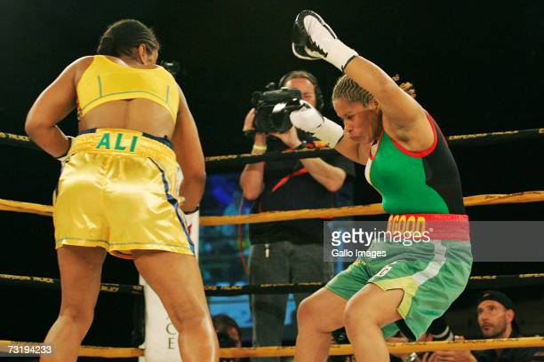 Lalia Ali of the USA knocks down Gwendolyn O'Neil of Guyana during the WBC/WIBA Super Middleweight World Title bout at Emperors Palace February 3...