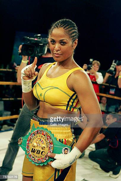 Lalia Ali of USA poses after defeating Gwendolyn O'Neil of Guyana during the WBC/WIBA Super Middleweight World Title bout between Lalia Ali and...