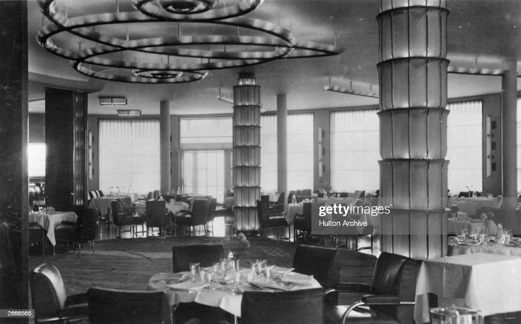 Lalique columns in the art deco interior of a luxury dining room on the new French liner Normandie a groundbreaking vessel of the CGT