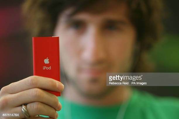 Lallier Benjamin plays with Apple's new Red iPod Nano at the Apple Store on Regent Street in central London