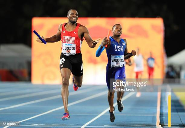 Lalonde Gordon of team Trinidad and Tobago and David Verburg of team USA cross the finishline in heat one of the Men's 4 x 400 Meters Relay during...