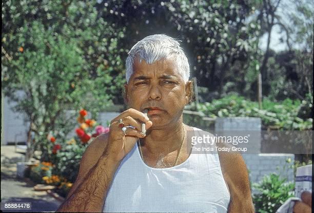 Laloo Prasad Yadav Chief of Rashtriya Janata Dal washing his teeth with Neem stick
