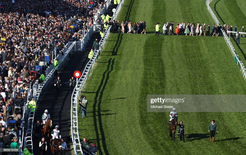 Lalor ridden by Richard Johnson is paraded to the crowd following victory during the Weatherbys Private Bank Standard Open NH Flat Race on Ladies Day at Aintree Racecourse on April 7, 2017 in Liverpool, England.