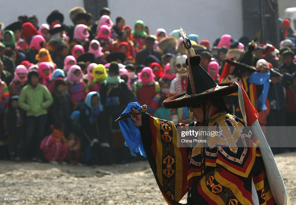 A lama dances during the 'Tiaoqian' praying ceremony at the Youning Temple on February 8, 2009 in Huzhu County of Qinghai Province, China. The Youning Temple holds the annual 'Tiaoqian' ceremony in the first lunar month each year. During the ceremony, monks will wear colourful traditional clothes and masks, performing the 'Fawang Dance' and 'Horse-headed Warrior Dance' to scare away evil spirits. Pilgrims also pray for good luck during the ceremony.