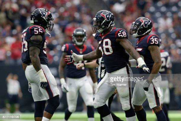 Lamar Houston of the Houston Texans congratulates Benardrick McKinney after a second half sack against the Indianapolis Colts at NRG Stadium on...