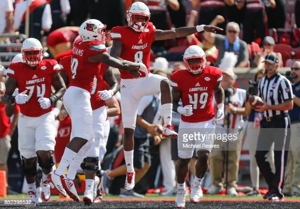Lamar Jackson of the Louisville Cardinals celebrates with Malik Williams after a touchdown against the Kent State Golden Flashes during the first...